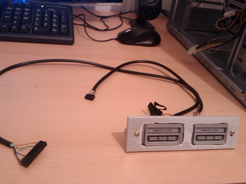 playstation memory card reader yoan built the adapter inside a psone using the built in slot and power sources he then connects a custom cable from a 8p8c rj45 connector mounted on the